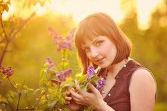 Young woman in lilac flowers Royalty Free Stock Photos