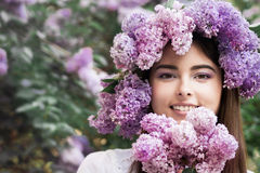 young woman with lilac flowers Stock Images