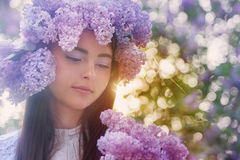 Young woman with lilac flowers Royalty Free Stock Photo