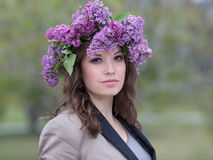 Young woman in lilac wreath outdoors Stock Photo