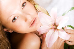 Young woman with lily Royalty Free Stock Photo