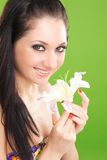 Young woman with lily flower Stock Photos