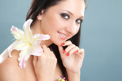 Young woman with lily flower Stock Image