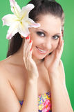 Young woman with lily flower Royalty Free Stock Photos