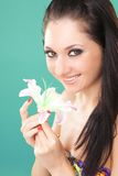 Young woman with lily flower Royalty Free Stock Photo