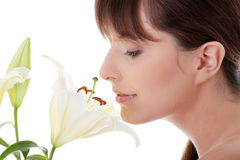 Young woman with lily flower Stock Photography
