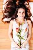 Young woman with lily Stock Photos