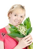Young woman with  Lily of the valley Royalty Free Stock Images