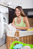Young woman with linen basket Royalty Free Stock Images