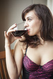 Young Woman in Lingerie Drinking Red Wine Royalty Free Stock Images