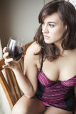 Young Woman in Lingerie Drinking Red Wine Stock Image