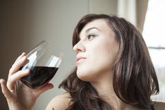 Young Woman in Lingerie Drinking Red Wine Royalty Free Stock Photography