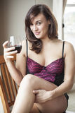 Young Woman in Lingerie Drinking Red Wine Royalty Free Stock Photos