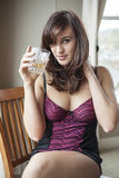 Young Woman in Lingerie Drinking Scotch Royalty Free Stock Photography