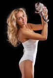 Young woman in lingerie holding chinchilla over black background Royalty Free Stock Images