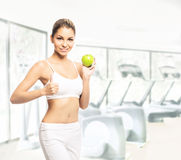 A young woman in lingerie holding a fresh green apple Royalty Free Stock Images