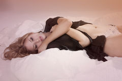 Young Woman in Lingerie Lying in Bed Royalty Free Stock Photos