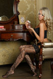 Young woman in lingerie with perfume. Royalty Free Stock Photography
