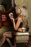 Young woman in lingerie with perfume. Royalty Free Stock Images