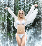 A young woman in lingerie posing near a waterfall Royalty Free Stock Images