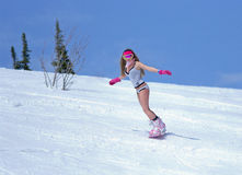 Young woman in lingerie on a snowboard Stock Image