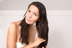 Young woman in lingerie styling her hair Stock Photo