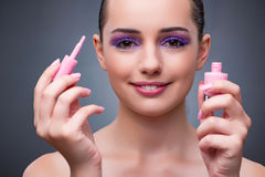 The young woman with lipstick in beaut concept Stock Images