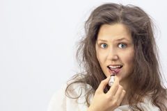 Young woman with lipstick Stock Photos