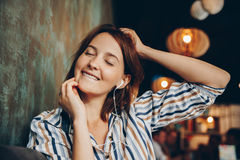 Young woman listen music with headphones and relaxing. Stock Photography