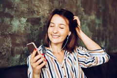 Young woman listen music with headphones and relaxing. Sitting  on cafe, domestic atmosphere. Positive emotion, Royalty Free Stock Image