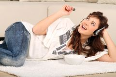 Young woman listen to music Royalty Free Stock Images