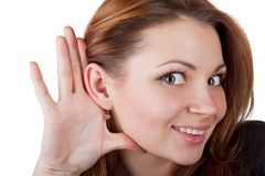 Young woman listening Royalty Free Stock Photography