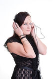 Young woman listening headphones Royalty Free Stock Photography