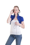 Young woman listening headphones Stock Photography