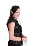 Young woman listening headphones Stock Images