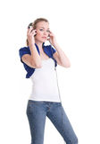 Young woman listening headphones Royalty Free Stock Images