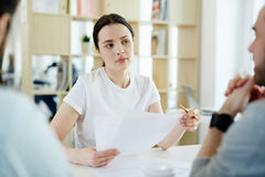 Young Woman Listening in Meeting with Clients Stock Image