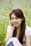 Young woman listening music. Outdoors Stock Photography