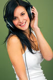 Young woman listening music Stock Images