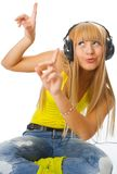 Young woman listening music Royalty Free Stock Photos