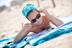 Young woman listening music on the beach Royalty Free Stock Photo