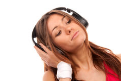 Young woman listening music in big headphones Royalty Free Stock Photo