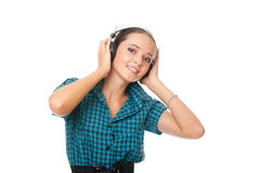 Young woman listening music in big headphones Stock Photography