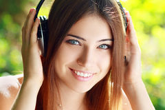 Young woman listening music Royalty Free Stock Image