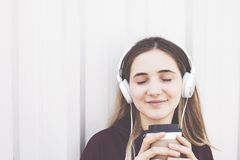 Young woman listening music with earphone. Young woman listening  music with earphone Stock Photography