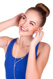 Young woman listening music and entertaining. Stock Image Royalty Free Stock Photo