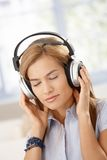 Young woman listening music eyes closed Stock Images
