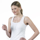 Young woman listening music with headphones. And with withe t-shirt Royalty Free Stock Images