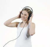 Young woman listening music with headphones Stock Photo