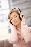 Young woman listening music on headphones Royalty Free Stock Photography